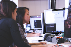 Two women pair programming